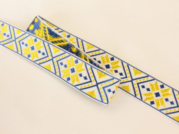 Фото 3 - ЛЕНТА ОТДЕЛОЧНАЯ ЖАККАРД белый,т-синий,желтый 32мм.