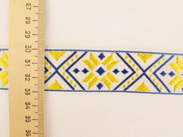 Фото 5 - ЛЕНТА ОТДЕЛОЧНАЯ ЖАККАРД белый,т-синий,желтый 32мм.