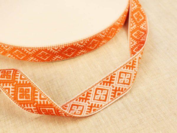 Фото 3 - ЛЕНТА ОТДЕЛОЧНАЯ ЖАККАРД белый с оранжевым 25мм.